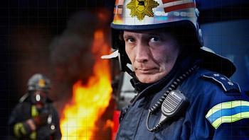 Firefighter-with-digital-handheld-walkie-talkie-radio.jpg